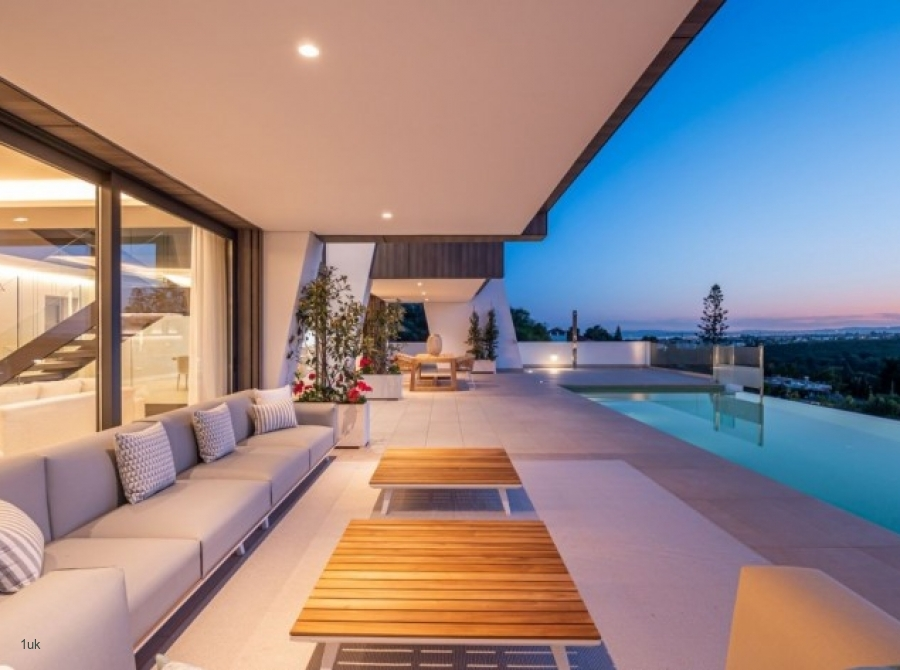Night time seating area and pool view