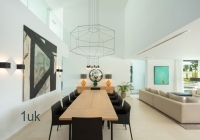 Open plan dining area and lounge area in villa in Marbella
