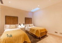 Another large bedroom with two single beds