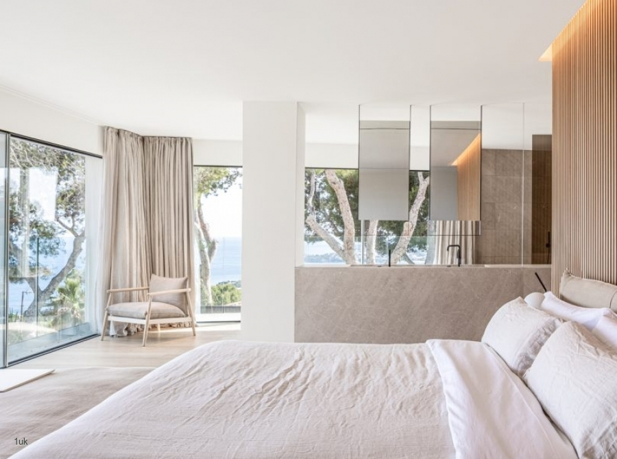 Master bedroom with large glass windows