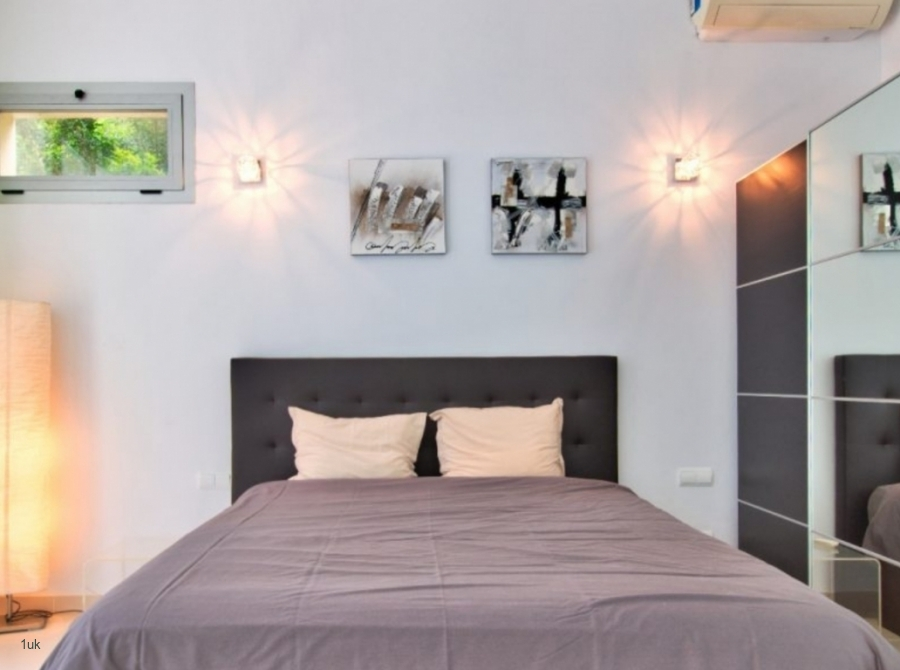 Bedroom with large mirror
