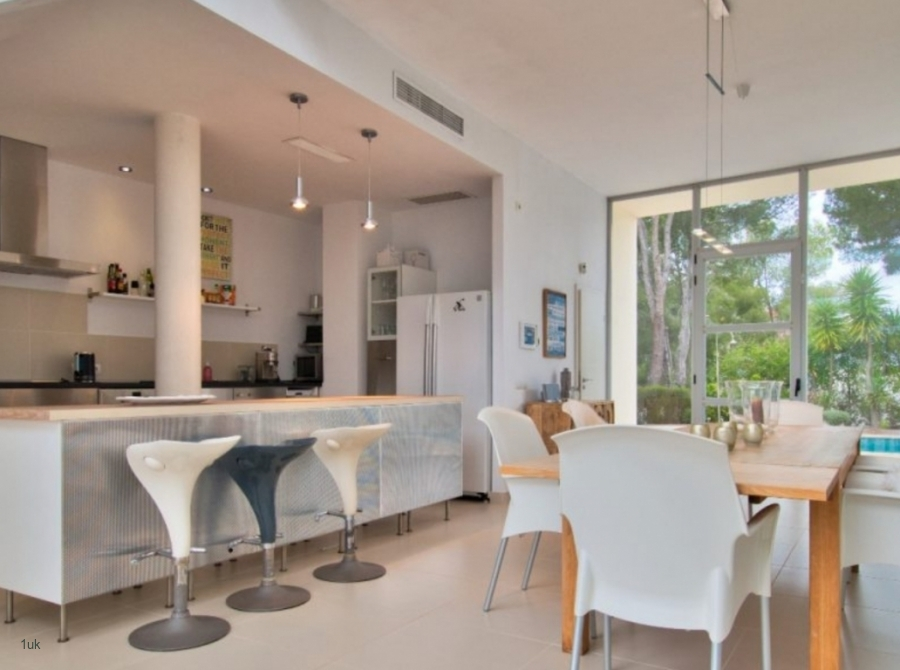 Dining and kitchen inside villa