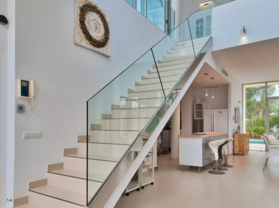 Staircase with glass rail