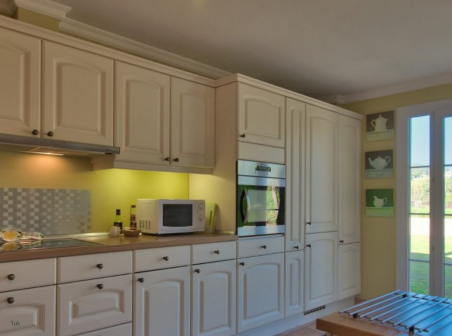 Cream and lime kitchen with oven and microwave in Mallorca