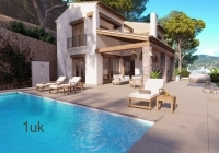 Sun Loungers with cushions over looking the swimming pool
